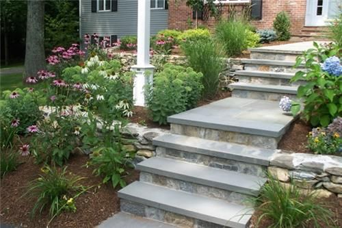 Beautiful example of traditional landscape design, with Hydrangeas, Echinacea, and that lovely stonework. From Brookside Landscape Contractors of CT.