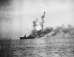 A kamikaze strikes St. Lo, causing an enormous fireball.