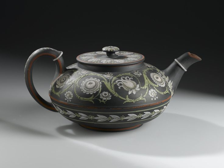 Cover for a teapot of black basalt ware decorated in green and pink enamel colours with bands of floral scroll and laurel: English, Staffordshire, Etruria, by Wedgwood, 1810 - 1850