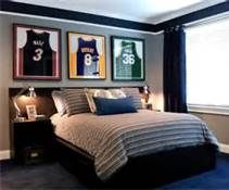 Framed jerseys over bed! Would have to be football of course. Go Vikings!!