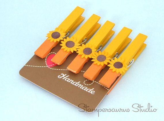 This listing is for five (5) clothespins which been hand painted with acrylic paint on both sides. A paper sunflower has been attached to each pin. Lightly sanded for that rustic, distressed look. Perfect for Autumn or Thanksgiving! These have many uses:    +Clothespins are perfect for holding a cookbook open to the right page  +Use clothespins to keep bread and chip bags closed  +Keep a trash bag in place in the trash can. Add a couple of pins along the top edge of the can and the bag will…