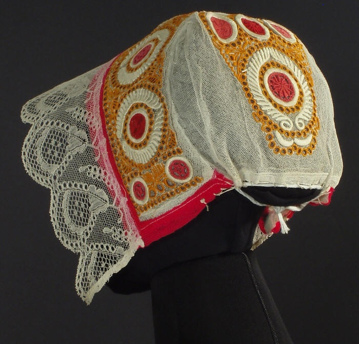 Antique Slovak Folk Costume Cap from Drahovce, Slovakia  Adult size   beautiful handmade bonnet from western Slovakia, likely from Drahovce or one of the surrounding villages northeast of Trnava. The cap is hand embroidered with colored threads on tulle and embellished with wide lace (handmade bobbin lace I believe) on the front. The cap dates to the early 20th century