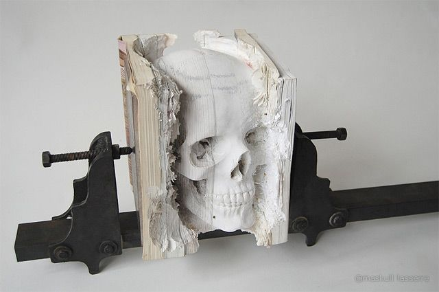 Skull carved from old computer manual.