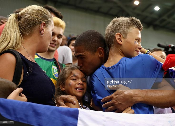 Daniel Narcisse of France celebrates their victory with his children after the…