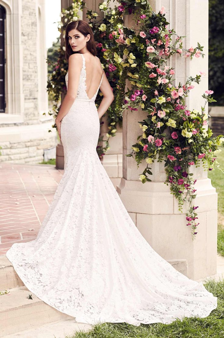 View Sheer Lace Wedding Dress - Style #4746 from Paloma Blanca. Paloma Lace gown with V-neckline on bodice lined in Nude Tulle. Fit and flare lace skirt.