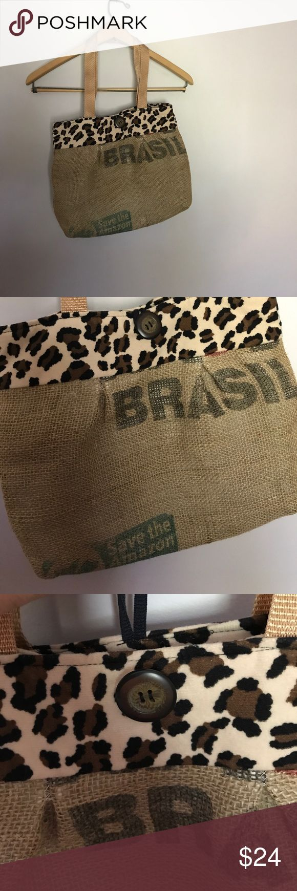 Upscaled Burlap Purse Coffee bean burlap sack upscaled into a darling purse. Fully lined with leopard print felt, a large side pocket inside and button with loophole latch. Like new!  Go green...buy Posh! Bags