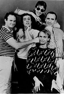 """Men At Work - Popular band from Australia who hit international stardom in the early 1980's with hits like """"Down Under"""" and """" Overkill"""",etc. Colin Hay (the lead singer) and most of the original lineup still tour today ( except for founding member Greg Ham who died in 2012). Men At Work's discography was basically three studio albums....but their hits are 80's iconic songs."""