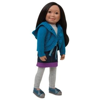 Nunavut Now: This layered outfit enables Saila to adapt her school day outfit to the weather. The weather this morning calls for her to wear her hooded cable knit sweater over her long sleeved grey heathered shirt, her denim skirt with a fun rolled up hem and matching grey heathered leggings. She completes her outfit with a traditional woven belt and her favourite comfy canvas shoes.