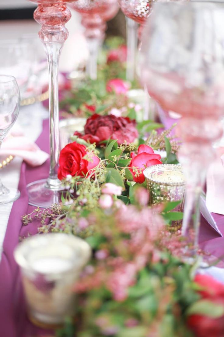 table centerpiece from a berry hued wedding inspiration