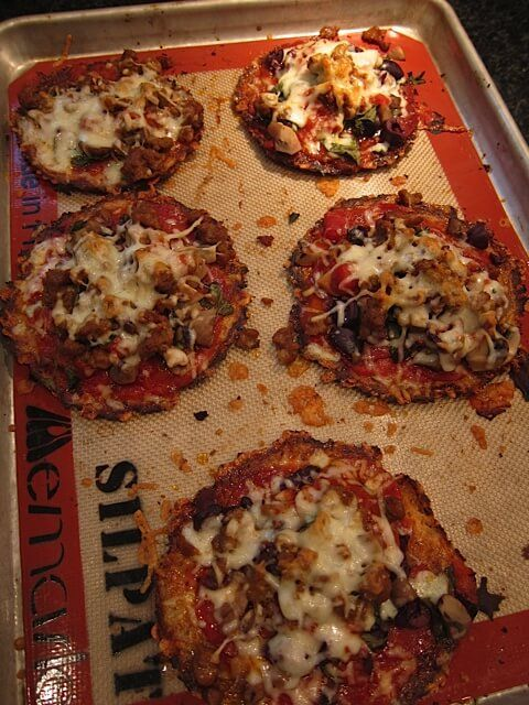 There are a lot of recipes for cauliflower crust pizza recipes out there but this one is absolutely delicious. (and crispy!)