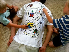 use fabric paint to make a race track on the back of men's tshirts for kids and their matchbox cars