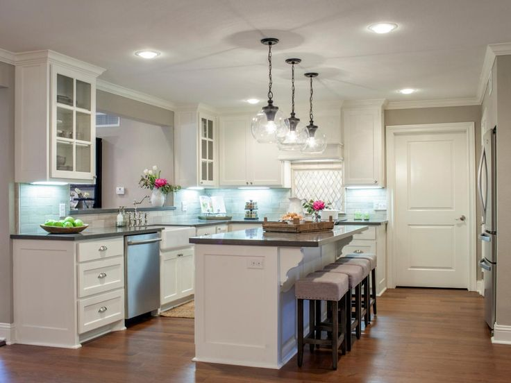 Kitchen Island with Sophisticated Extras and Glass Globe Pendant Lighting