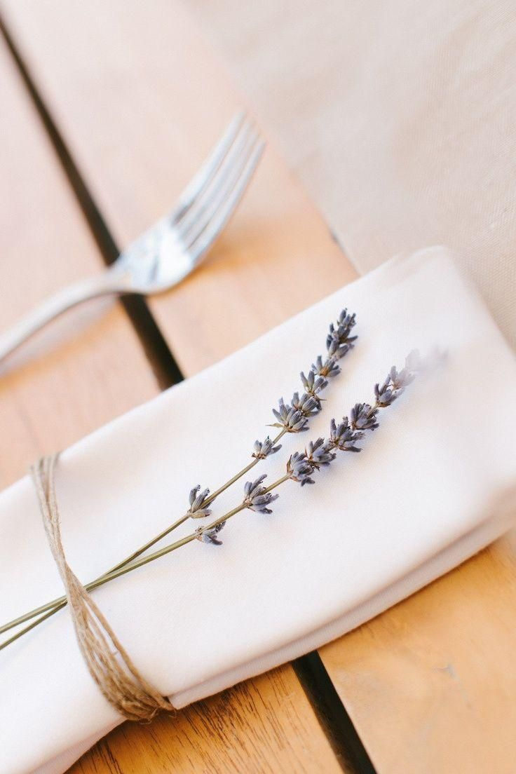 Beautiful idea for wedding reception | lavender stems on each napkin