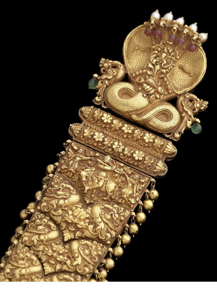 India | Close up of an intricate gold braid; one of the 28 pieces that Bonhams is about to sell ~ an inspiring array of Indian Temple Jewellery from the 17th, 18th, and 19th centuries, all from one impressive private collection. Each of the 28 pieces were used to ornament the Hindu gods. As tributes to the deities, these works of art are beautifully made of gold, diamonds and rubies combined with centuries old Indian craftsmanship.