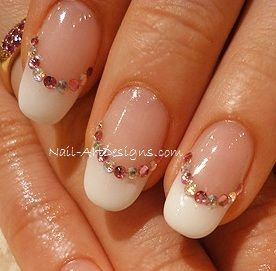 I'm not a big fan of the French Manicure...as active as I am, it shows dirt much too easily (even with hand washing).  So, while I love this design (specifically the bling of it), I'd try it with some bold color.  classy nail art - Google Search
