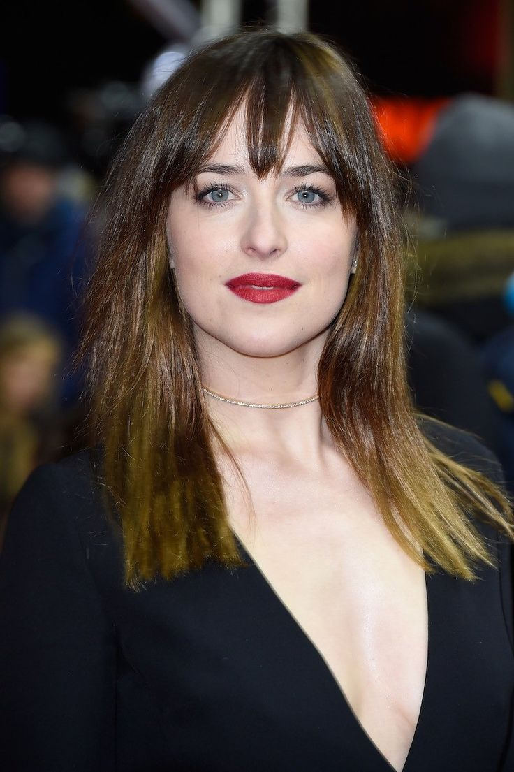 Dakota Johnson Embraces the Modern Sex Appeal of a Plunging Neckline and Red Lipstick