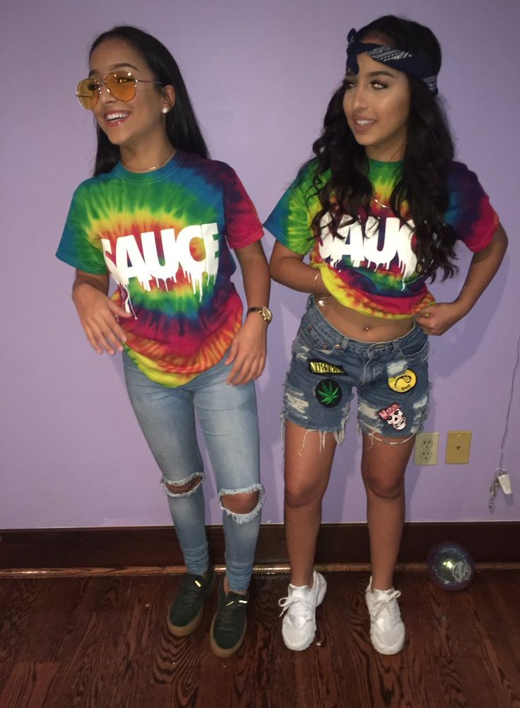 """(Warm) Left Twin: - Tented """"Hippie"""" Glasses, Tie dye Shirt, De-stressed Blue Jeans, Black Pumas. Right Twin: - Black Bandana, Tie Dye Shirt, Patched De-stressed Shorts, White Sneakers"""