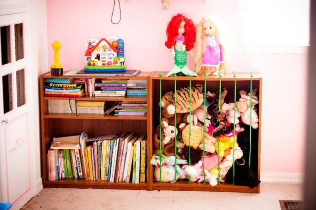20+ Creative DIY Ways to Organize and Store Stuffed Animal Toys --> Use Bookshelf and Bungee Cords to Build Stuffed Animal Zoo
