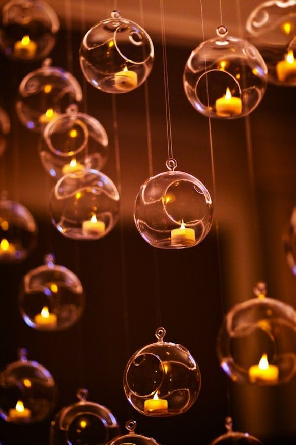 Tea Light Bubbles: Cascading candlelight makes for a luminous and delicate alternative to a traditional chandelier.  We love this idea for rehearsal dinners, weddings, and even holiday parties.