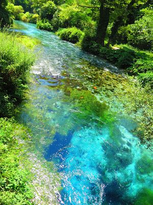 The Blue Eye, Albania. These are the actual colours. Fast flowing karst (cave) spring of unknown depth, very cold, very clear water.