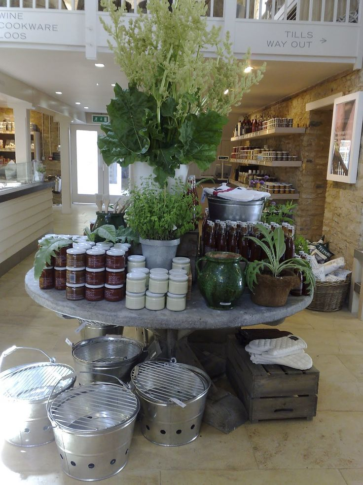 daylesford organics display....how about having a small elegant round table, with tiers for self serve prepackaged baked goods?