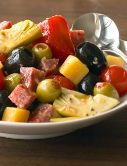 You'll love the color and texture of Antipasto Salad, a make-ahead appetizer or snack: Black and green olives mixed with salami, cheese, marinated vegetables and red wine garlic vinaigrette for a tasty take on everybody's Italian favorite. You can make individual bites by skewering a few morsels on a toothpick and presenting them decoratively on a serving tray, or serve it in a festive bowl and allow your guests to serve themselves.