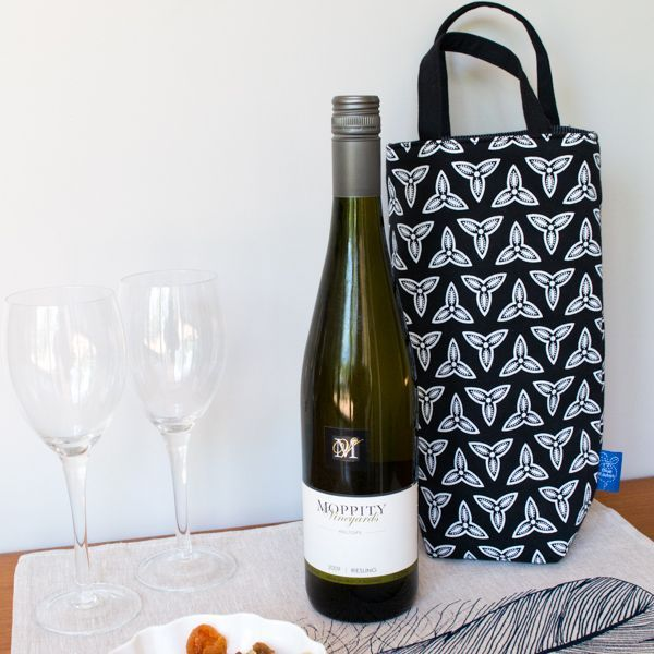 Insulated wine tote in trefoil design handprinted in white ink onto black linen-cotton fabric. The insulation has a foil layer to reflect heat and cold back into the bag. $39. Click the image to shop.