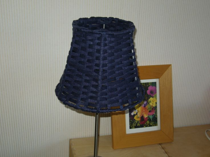 A woven lampshade with textile yarn.
