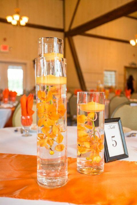 25 best ideas about orange wedding centerpieces on for Orange centerpieces for tables