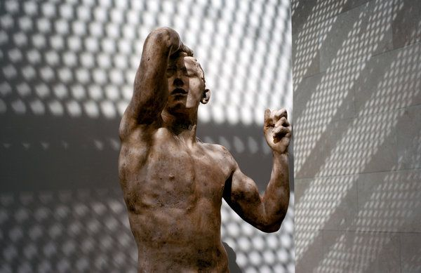 Rodin's Age of Bronze at the Nasher Sculpture Center in Dallas. The museum says reflected sunlight from a nearby high-rise tower is disruptive and damaging to artworks. (Brandon Thibodeaux for The New York Times)