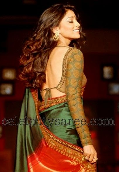 color of the saree - deep green and brocade blouse