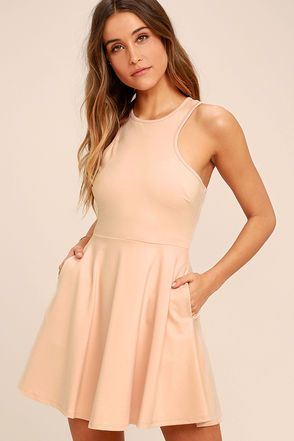 The Little Wonder Beige Skater Dress Knows How To Make A Big Statement This Wear Anywhere Knit Has Sleeveless Darted Bodice Fitted Waist