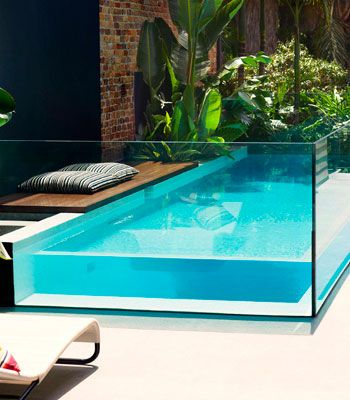 Boxing clever    For this inner-city Sydney home, the architect encased the pool in a box of 38mm-thick glass, which functions as both pool wall and security fence.