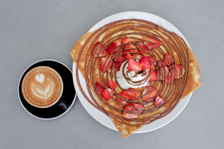 Nutella, strawberries and ice cream crepe with a coffee - Four Frogs Creperie
