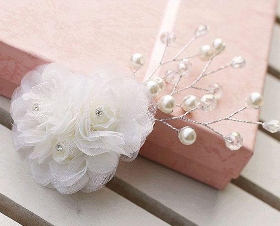 Check out this item in my Etsy shop https://www.etsy.com/listing/208895814/bridal-hairpiece-elegant-bride-white