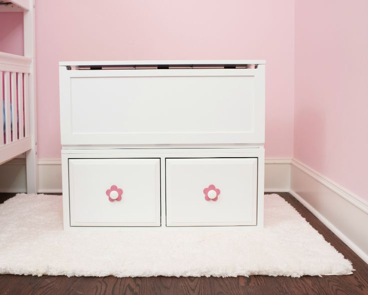 Kid's toy chest with pullout drawers for a kid's room or playroom. Dressed up with our knob backers. Perfect kid's toy storage.