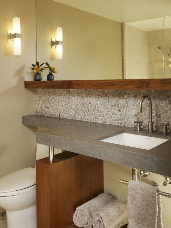 bathroom by michael tauber wood shelf and backsplash of riverrock