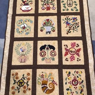 This is a block of the month that I have been working on for several years. Each block depicts a month of the year and is hand appliquéd.
