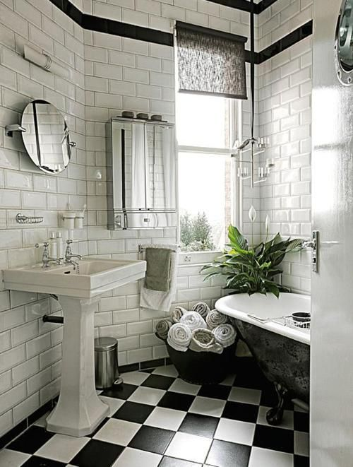 black and white bathroom, subway tile. Very cute, but I would add bright turquoise towels and accessories.