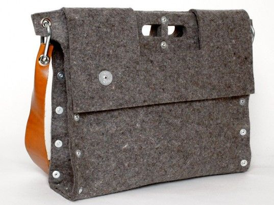 #Carga's industrial-cool bags. Each minimalist bag is hand-assembled in Buenos Aires from a sheet of recycled felt, then fastened together with heavy-duty rivets.