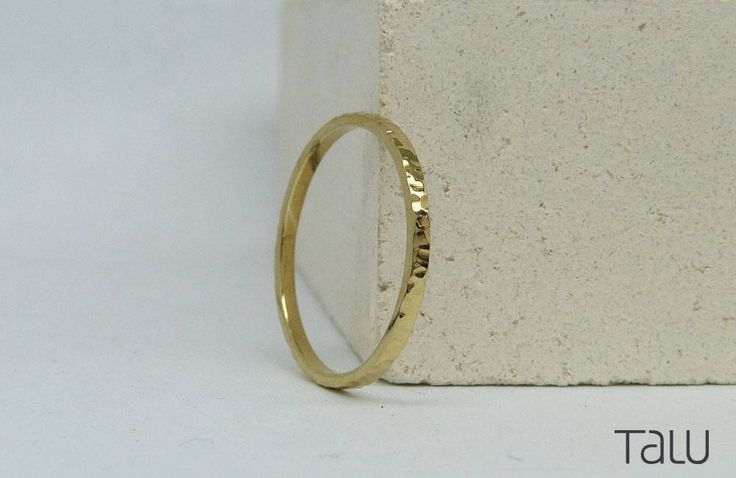 A personal favourite from my Etsy shop https://www.etsy.com/listing/510283576/gold-hammered-ring-thin-wedding-ring
