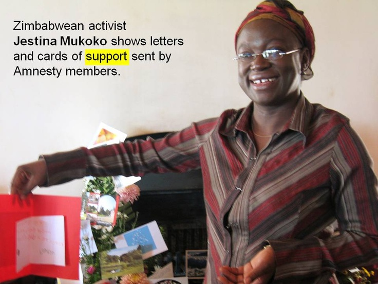 Zimbabwean activist Jestina Mukoko shows letters and cards of support sent by Amnesty members.