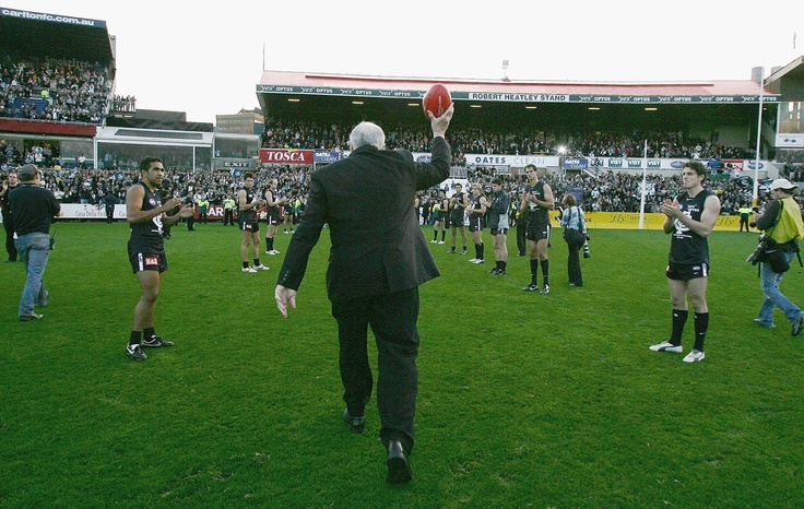 John Nicholls lifts the ball to the crowd at the conclusion of the final match played at Princes Park.