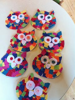 owls made of fabric scraps on a cereal box base; might try with scrapbooking paper