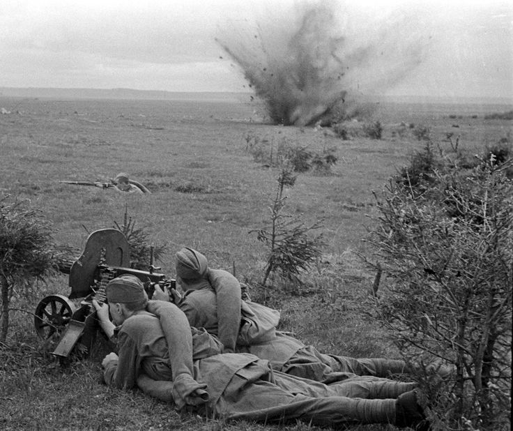 Soviet machine gunners of 20th Army fire on German positions on the Dnieper River during the First Battle of Smolensk following Germany's initial invasion of the Soviet Union. Note how none of the Soviet troops wear helmets which continued being in shortage well into the war. Near Dorogobuzh, Smolensk Oblast, Russia, Soviet Union. 1 September 1941.