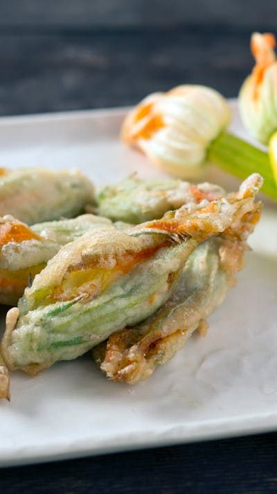 Flowers can be cheesy. But deep-fried zucchini blossoms make them delicious too.
