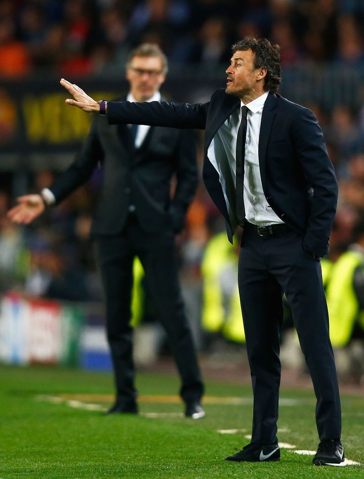 Laurent Blanc head coach of PSG and Luis Enrique manager of Barcelona gesture from the touchline during the UEFA Champions League Quarter Final second leg match between FC Barcelona and Paris Saint-Germain at Camp Nou on April 21, 2015 in Barcelona, Catalonia.
