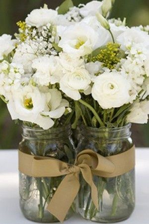 Maybe if I have to go cheap on my wedding, ill do something like this. Cheap yet cute :)- Mason jars