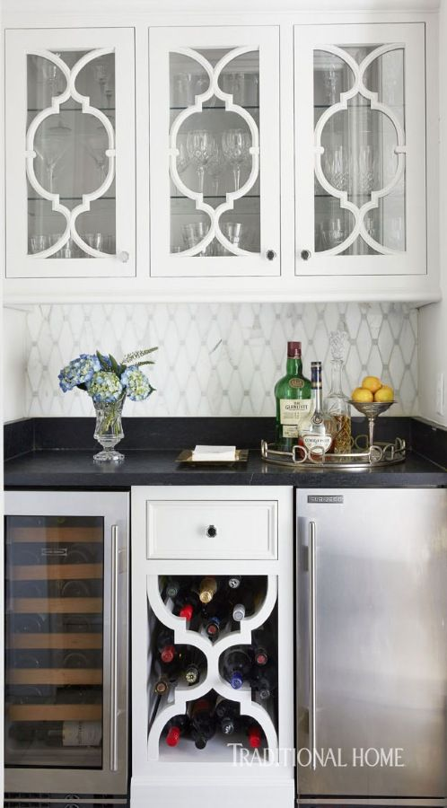 Fretwork adorns cabinets in the pantry space between the kitchen and dining room. - Photo: Jean Allsopp / Design: Dana Wolter