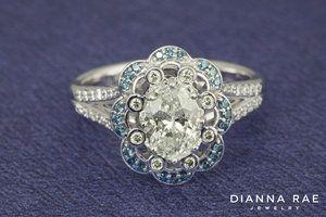 Glamorous Scalloped Oval Diamond Engagement Ring with Blue Diamonds